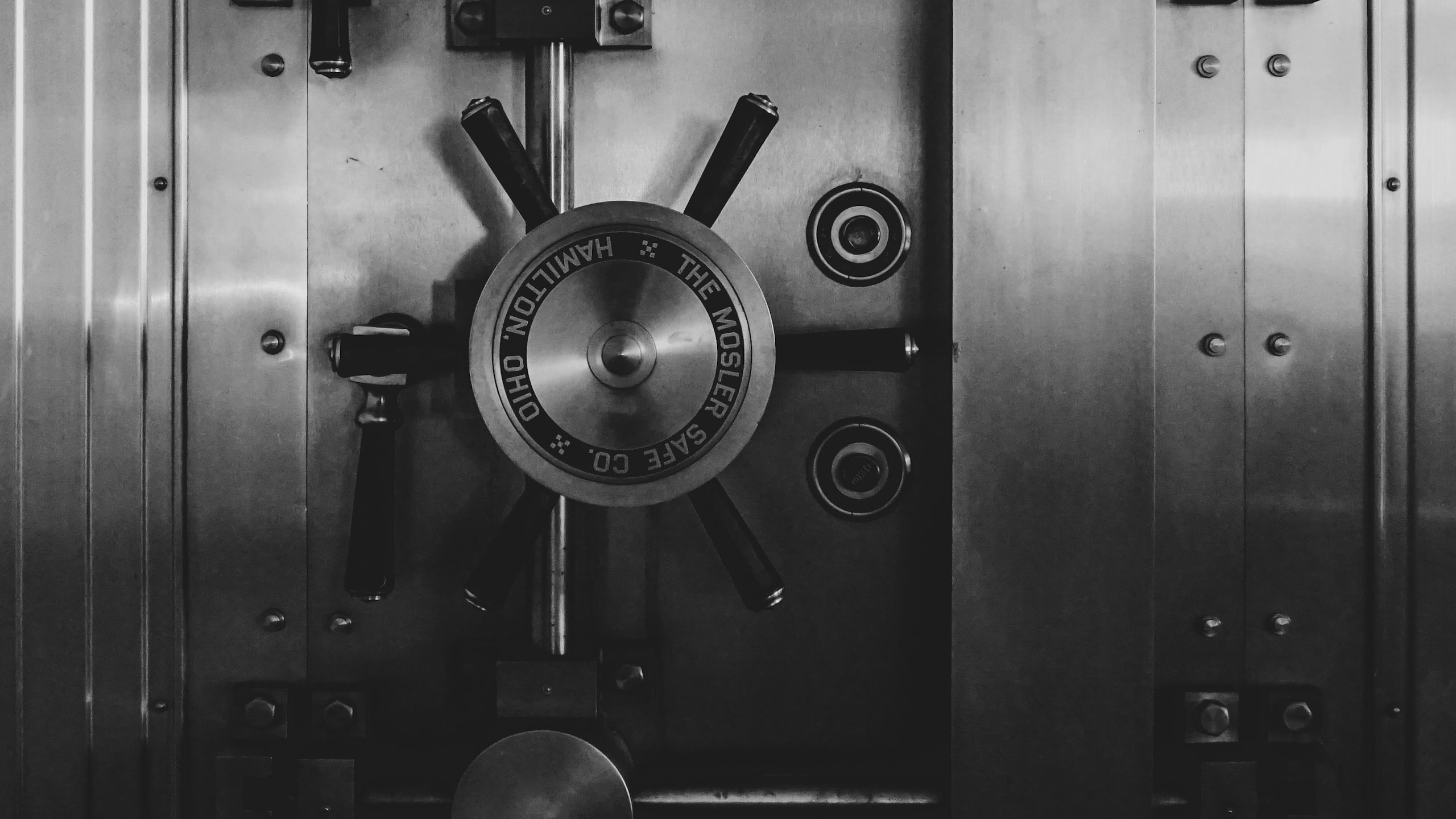 Black and white photo of a bank vault door
