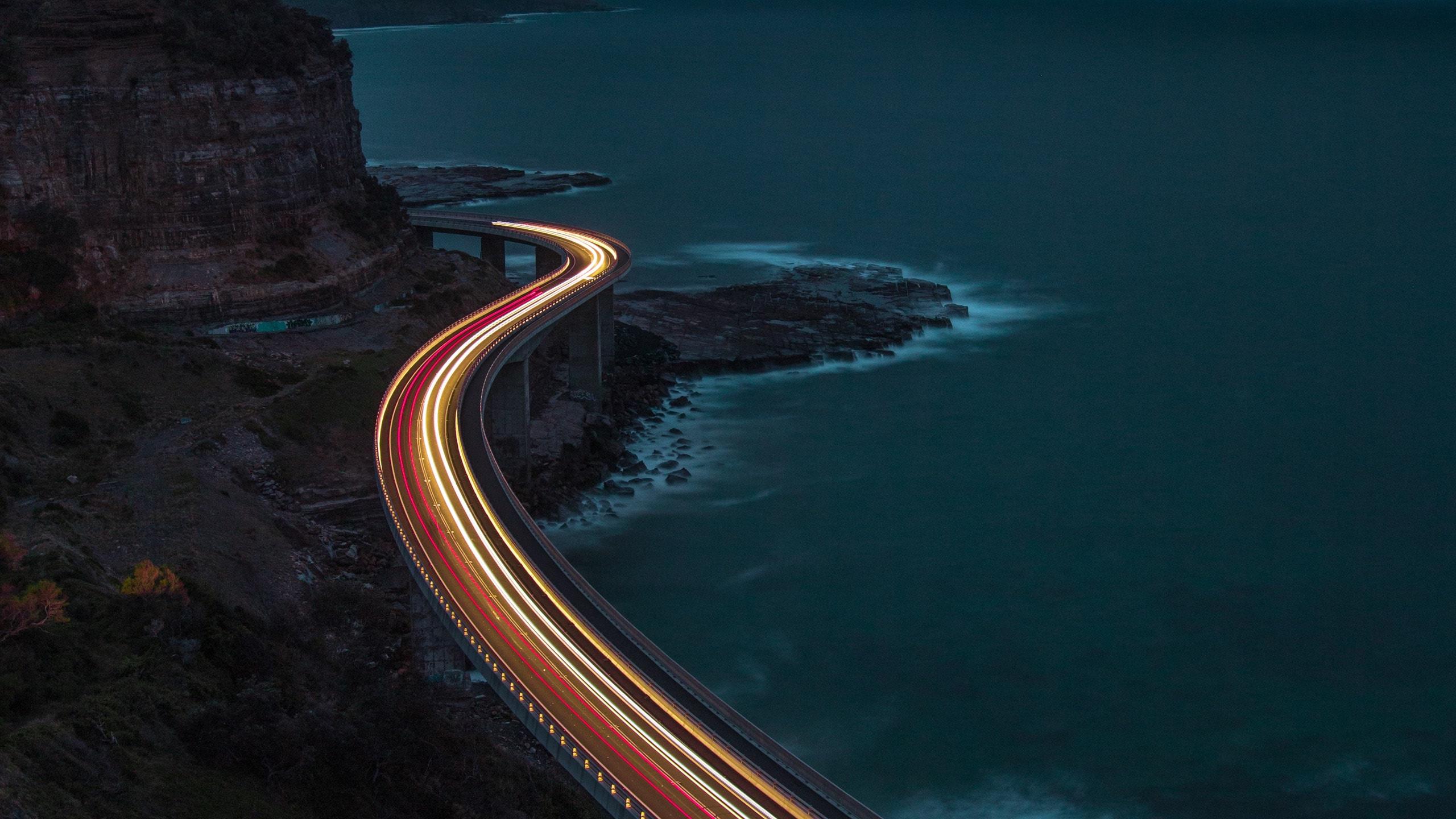 long exposure photo of a highway bridge over the sea