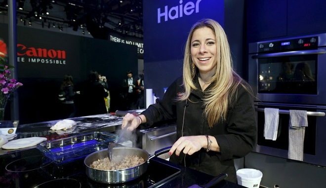 Chef Dana Cohen of the popular television show Hell's Kitchen chooses to use a Haier electric radiant cooktop to prepare a meal. Steve Marcus/Reuters