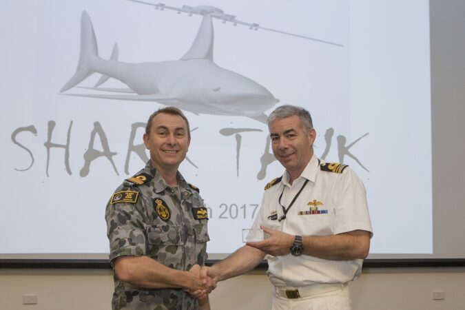 COMFAA congratulating LCDR Peter Stretton on the development of his concept and presenting him with a FAAST 'Presenters' Award.