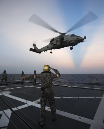 HMAS Ballarat's embarked MH60R Romeo Seahawk 'Gold Digger' conducts Helicopter In Flight Refuelling training with the flight deck team during the ship's South East Asia Deployment.