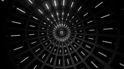 low angle photo of a tunnel showing a pattern of lights