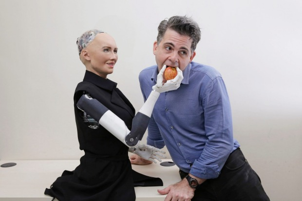 David Hanson, founder of Hanson Robotics with his company's flagship robot Sophia. It is proposed that robots should be regulated by rules based on Isaac Asimov's three laws of robotics. Photo: KIN CHEUNG