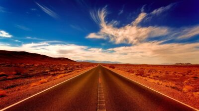 Image of a road in the desert (Flickr: https://www.flickr.com/photos/155486519@N03/35007792796)