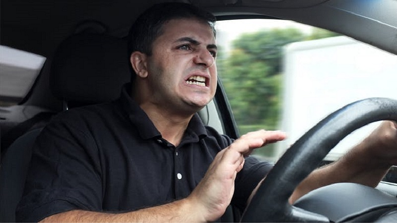 Picture of an angry man driving