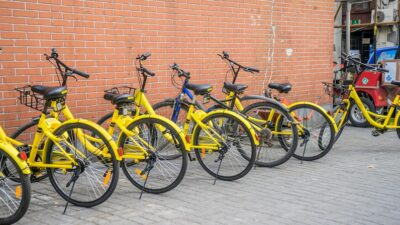 Flickr image of yellow bikes against a wall in China