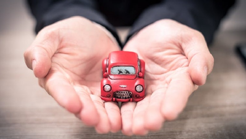 Image of a person holding a small red car https://www.shutterstock.com/image-photo/abstract-image-asian-business-man-hold-742873297?src=UN6PWOqP-tCw-s2jTfcTtQ-1-69