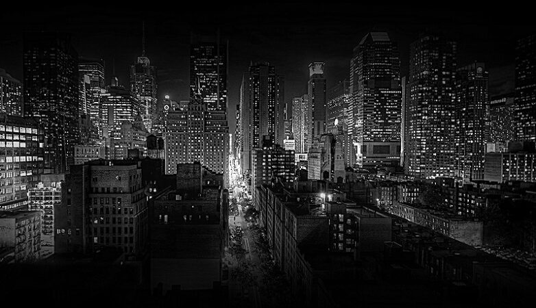 Black and white image of city with lights (source: Flickr)