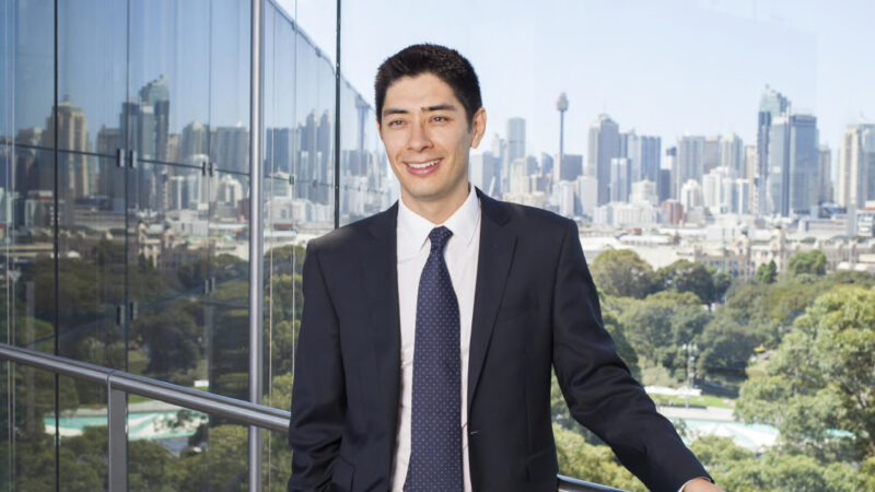 Profile photo of Eric Knight, in the background is the Sydney CBD