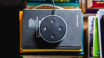 overhead photo of an Amazon Echo smart speaker on a pile of books