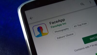 Photo of a phone showing the FaceApp install page on an app store