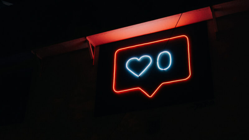 Photo of a neon sign showing a love heart and the number zero