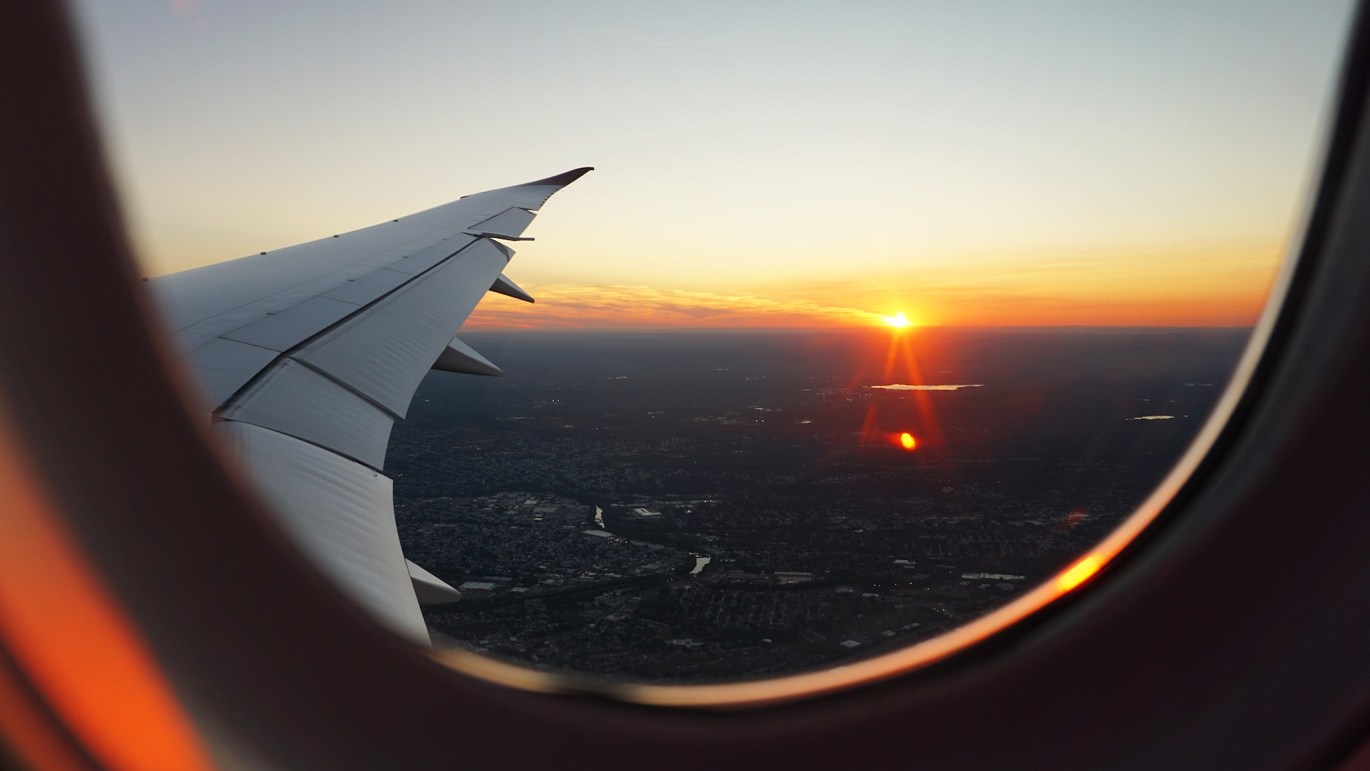 Photo of a sunset from a plane window