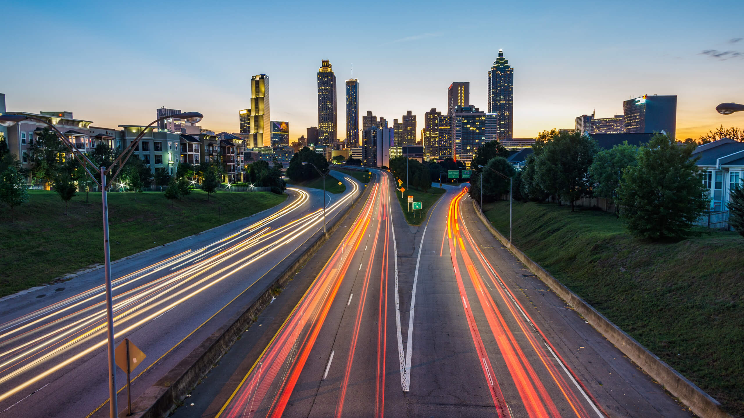 Timelapse photo of cars on a highway and a city in the background