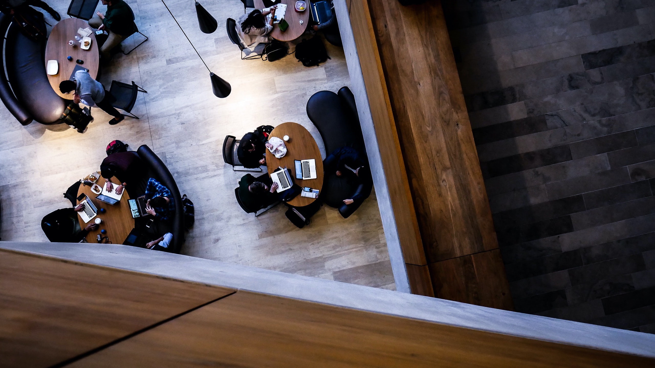 overhead photo of people sitting at tables