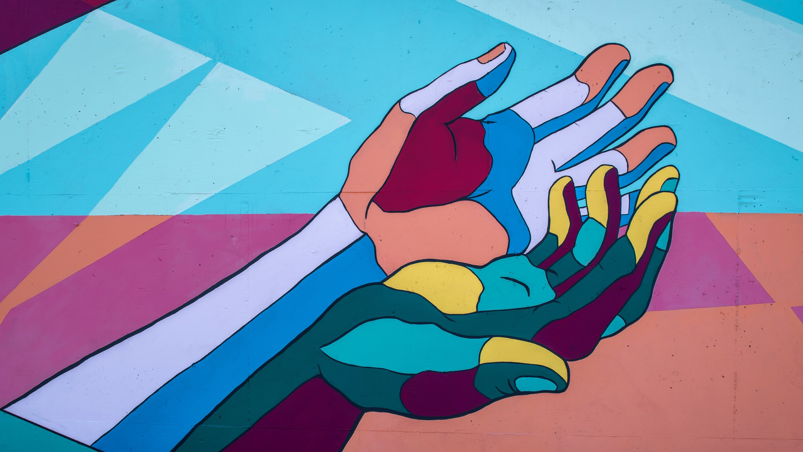 Artwork of two multicoloured hands reaching upwards