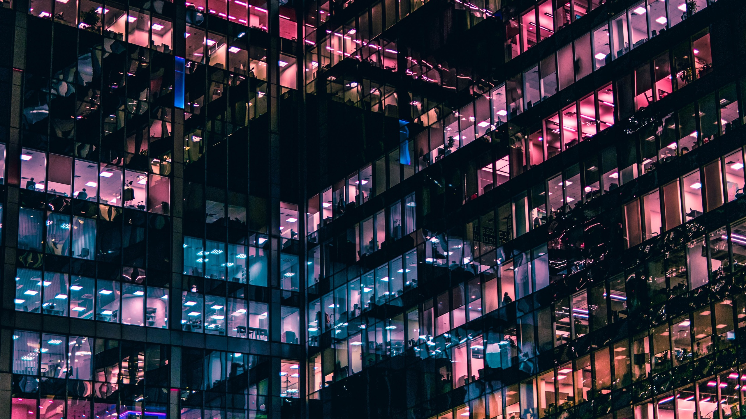 office building at night with multicoloured lights