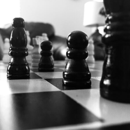 black and white photo of chess pieces