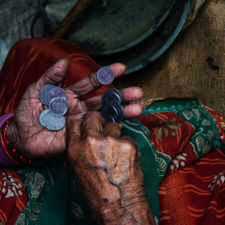 close up photo of a person counting coins in their hands