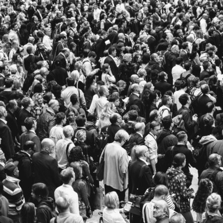 black and white photo of a large crowd of commuters
