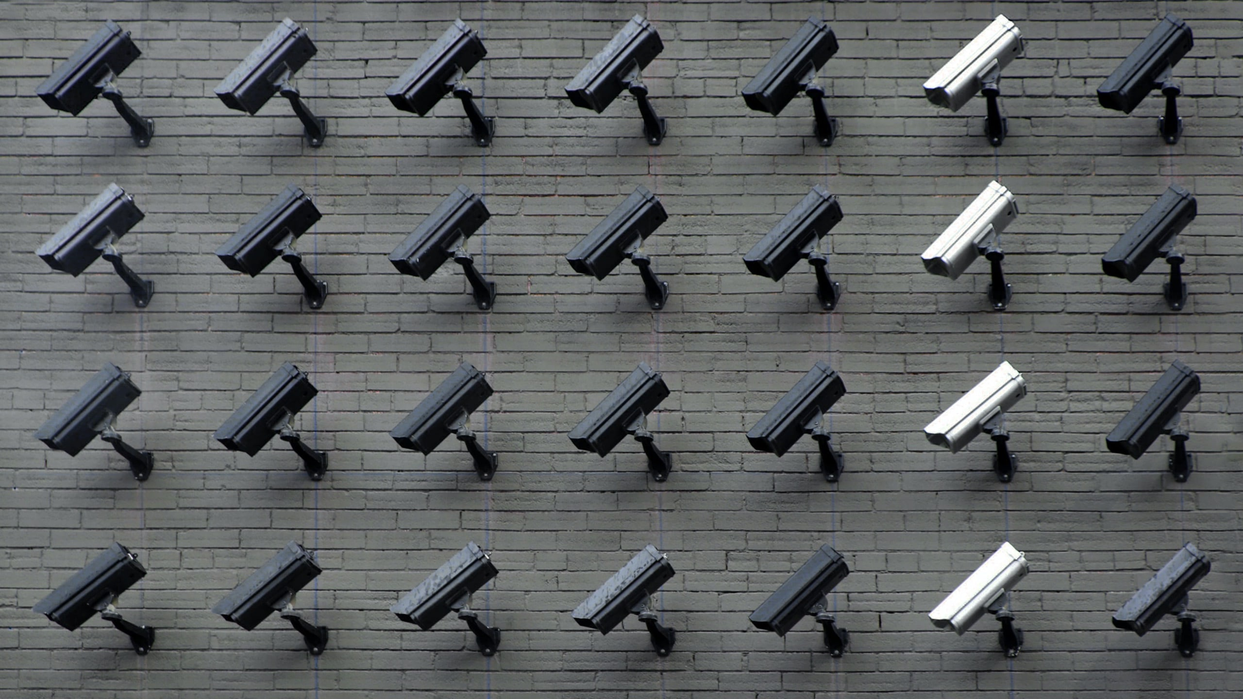 Group of security cameras on a wall