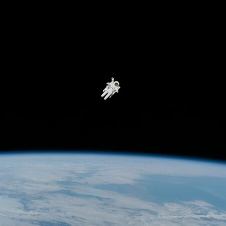 astronaut in a space suit above earth