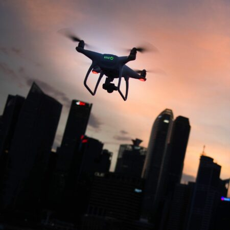drone flying above city buildings