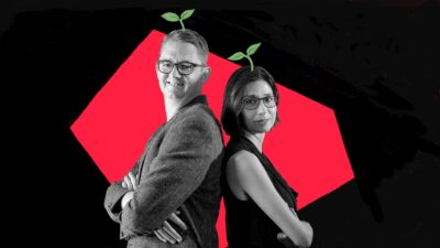 black and white photo of two people standing back to back, behind them is a red shape and above their heads are stylised plant emojis