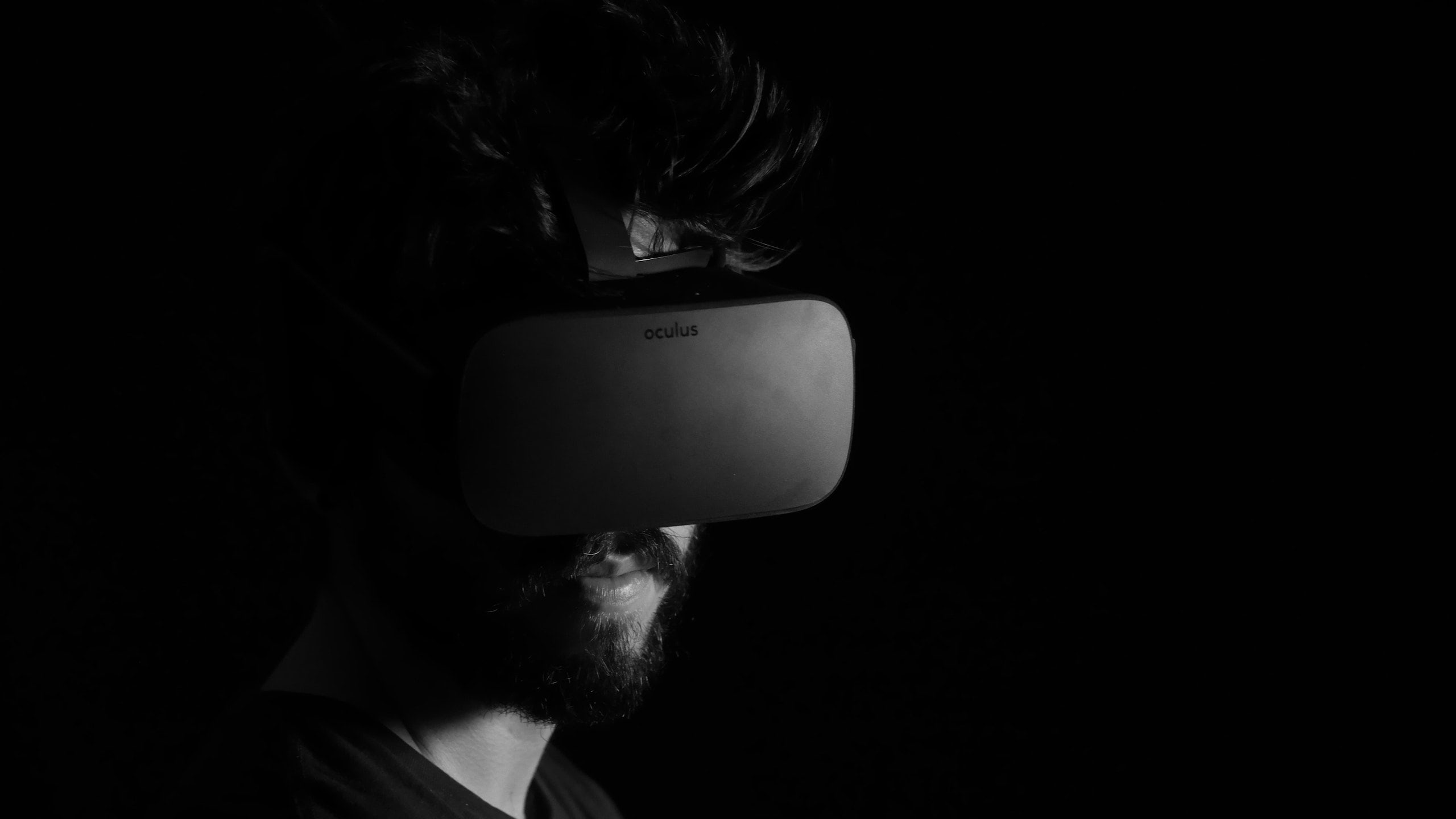 Person wearing a VR headset, their face is obscured by shadows