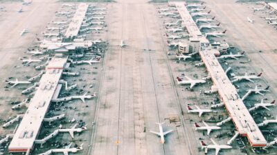 Aerial photo of an airport with planes lined up at terminals